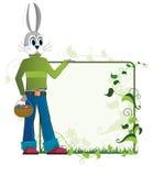 Lapin de Pâques avec un panier des oeufs Photographie stock libre de droits
