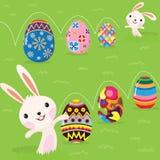 Lapin de Pâques espiègle avec les oeufs peints illustration libre de droits
