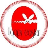 Lapin de Pâques de regard drôle dans un oeuf rouge photo libre de droits