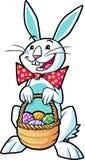 Lapin de Pâques retenant un panier Images stock