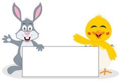 Lapin et poussin de Pâques avec la bannière vide Photographie stock