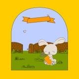 Lapin heureux avec la carotte Images stock