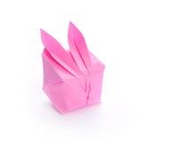 Lapin rose d'origami sur le blanc Photographie stock