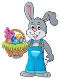 Lapin tenant le thème 1 de panier de Pâques Photographie stock libre de droits