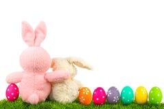 Lapins de Pâques avec la frontière d'oeufs Photographie stock