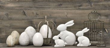 Lapins et oeufs de Pâques rétro décoration de style Images stock