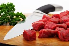 Lapje vlees en mes stock afbeelding
