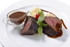 Lapje vlees met saus Royalty-vrije Stock Foto's
