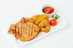 Lapje vlees met Tomatensaus en potatos stock afbeeldingen