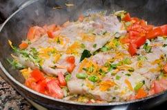 Lapjes vlees in de pan Stock Foto