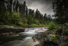 Lapland, Northen Finland. A river running trough the forest Lapland, Finland. Lemmenjoki National park stock images