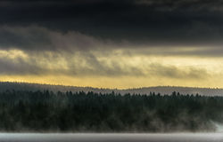 Lapland, Northen Finland. Sunrise in Lapland, Finland. Mist on the lake, dramatic clouds royalty free stock images