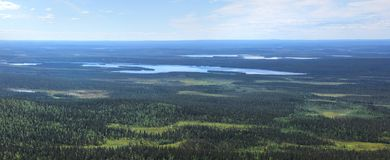 Lapland panoramic view from fell Pallastunturi. Beautiful panoramic view from fell Pallastunturi over forests, lakes and marshes of Lapland stock images
