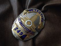 LApolisen förser med märke arkivfoton