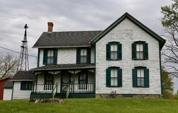 LaPorte Farmhouse. This is a Spring picture of a Farmhouse on top of a hill on a rainy day, located in LaPorte, Indiana in LaPorte County.  This two story wood Royalty Free Stock Photography