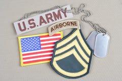 Lapp för sergeant för USA-ARMÉ frodig, luftburen flik, flaggalapp och hundetikett Fotografering för Bildbyråer