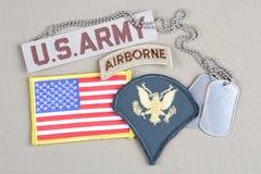 Lapp för specialist för USA-ARMÉ frodig, luftburen flik, flaggalapp och hundetikett Arkivbild