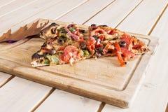 Lappa av Pizza Arkivfoto