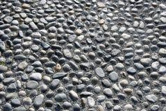 lappad stenläggning Arkivbilder