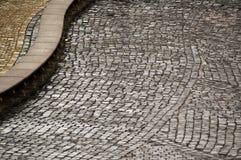 lappad trottoar Arkivbilder