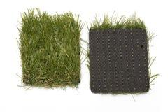Lappar av konstgjort gräs Arkivfoto