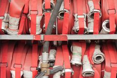 Lapped fire hoses on a fire truck Royalty Free Stock Photo