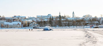 Lappeenranta. Finland. Frozen Saimaa Lake. LAPPEENRANTA, FINLAND - FEBRUARY 18, 2010: Winter landscape with boats in harbor on Saimaa Lake and buildings in Royalty Free Stock Photos