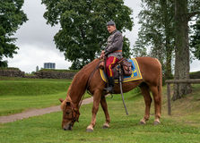 Lappeenranta, Finland - 29 July 2016: Horse riders in historical Finnish army uniform in the Lappeenranta harbor area. Lappeenranta, Finland - 29 July 2016 royalty free stock image