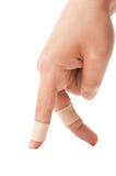 Lappfingrar som går på vit Arkivfoton