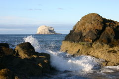 Lapping Waves frame Bass Rock. Bass Rock, North Berwick, Scotland from the mainland Stock Image
