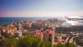 Laps de temps du panorama 4k de baie d'anneau de taureau de lumière du soleil de ville de l'Espagne Malaga clips vidéos
