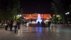 Lapso de tempo quadrado do Syntagma com cor alaranjada do parlamento vídeos de arquivo