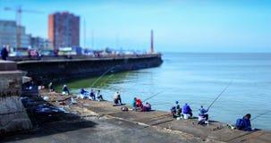 Lapso de tiempo de la gente que pesca en Escollera de Montevideo metrajes