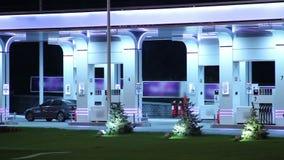 Lapso de tiempo de estación de gasolina, aprovisionando de combustible los coches, factor de venta de la gasolina metrajes