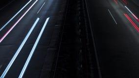 Lapso de tiempo de las luces de cabeza borrosa movimiento y de la cola - carretera almacen de metraje de vídeo