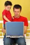 Laptop. Father and son working on laptop together Royalty Free Stock Image