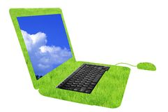 Laptop. Field of fresh green grass with laptop Royalty Free Stock Photos