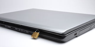 Laptop. A lock given a protection to laptop Royalty Free Stock Photos