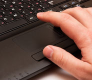 Laptop. Using a laptop, finger on touchpad Royalty Free Stock Photography