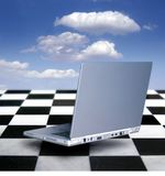 Laptop. A laptop hovering over black and white tiles Royalty Free Stock Image