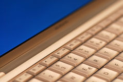 Laptop. A laptop keyboard with blue monitor stock images
