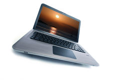 Laptop. Modern laptop new series with sunset in monitor Royalty Free Stock Photo