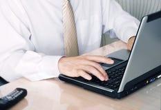 Laptop. Man's hands print on the laptop Stock Photos