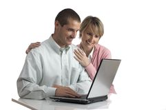Laptop. Young couple looking on the laptop screen
