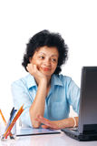 With Laptop. Elder woman looking on her laptop over white background Royalty Free Stock Photo