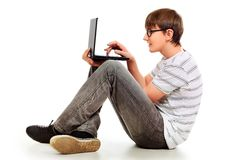 Laptop. Portrait of a smart young man with a laptop. Isolated over white background Royalty Free Stock Photography
