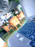 Laptop. Close-up in a hotel lobby. Shallow DOF