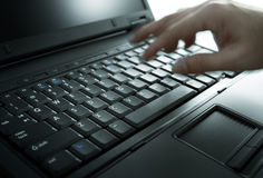 Laptop. Hand and laptop, swallow depth of field Stock Image