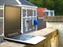 Laptop. On the edge of the balcony Royalty Free Stock Photos