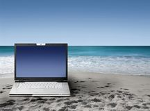 Laptop. On the beach in a sunny day Royalty Free Stock Image